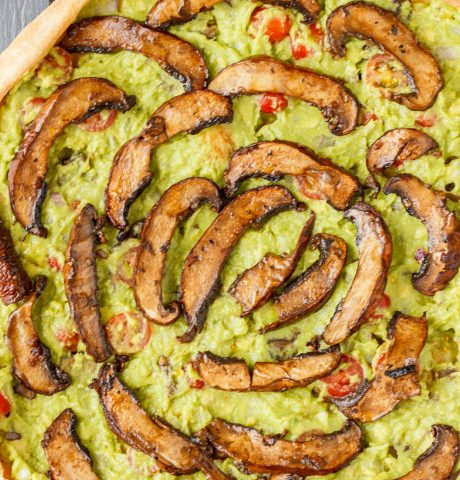 Guacamole mushroom style pizza close-up